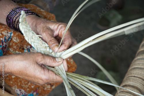 Photo  Working hands weaving