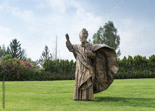 Staande foto Monument Bronze monument to Pope John Paul II on the lawn in front of the facade of the House of Galilee - Domus Galilaeae - near Vered Hagalil, Israel