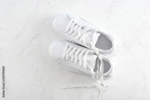 Fotomural sport white sneakers on white background