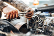 canvas print picture - dirty hands of auto mechanic reparing car