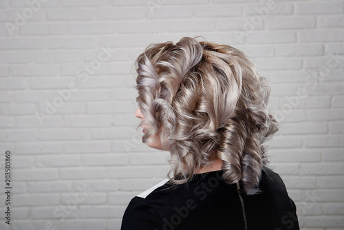 Hairstyle Short Curls On The Head Of A Blonde Close Up Back View On