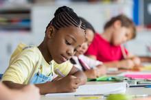 School Girl Writing In Class