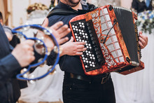 Musicians Playing On Accordion And Tambourine, Musical Band Performing At Wedding Reception. Fun Time At Party