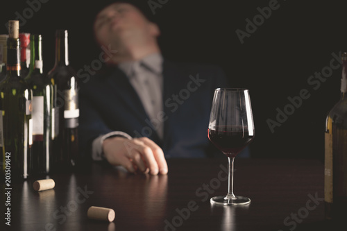 Fotografia, Obraz Businessman drunk by wine. Elegant alcoholic.