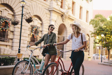 Friends Walking With Bicycles ...