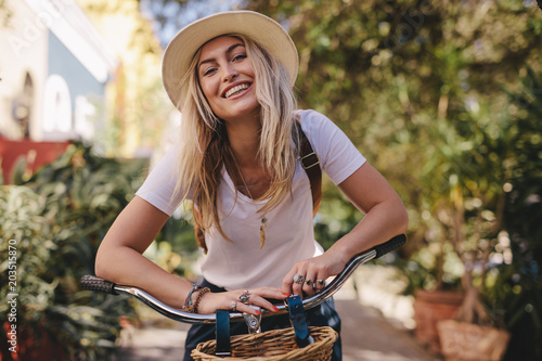 Fototapeta Beautiful woman with her bicycle outdoors obraz