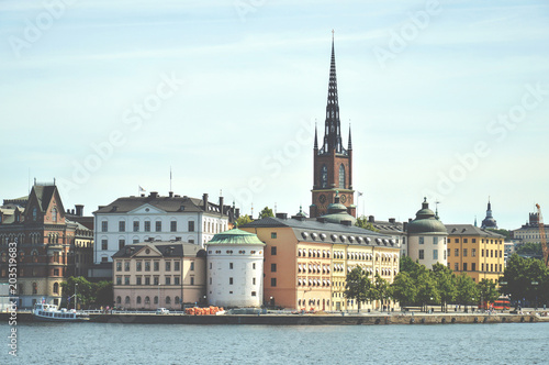Staande foto Stockholm Cityscape view of Stockholm's old town in famous Gamla Stan area densely situated by archaic buildings influenced by North German architecture