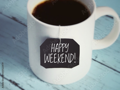 Photo Motivational and inspirational quote - 'Happy weekend!' written on a black piece of paper