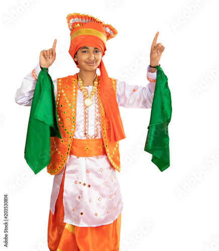 Fényképezés  Young Boy Dressed in a Traditional North Indian Bhangra Dance Costume, Isolated,