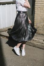 Woman In Street Twirling Metal...
