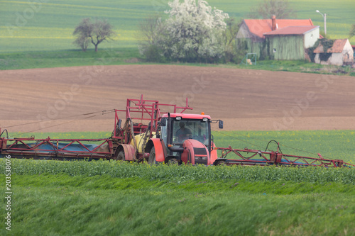 Foto op Aluminium Zalm Spring chemical treatment of cereals with red tractor
