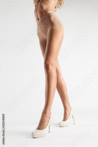 Poster Beige Tights. Long Woman Legs In Stockings