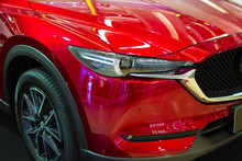 Close Up  Of Headlight In L Red Car Background. Modern And Expensive Sport Car Concept.background For Transport And Automotive Image.