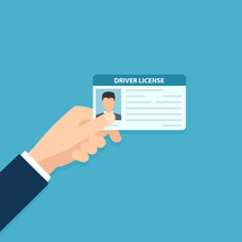 Hand Holding Car Driver License