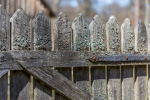 Old Wooden Fence Covered By Moss
