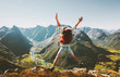 canvas print picture - Happy Man traveler jumping with backpack Travel Lifestyle adventure concept active summer vacations outdoor in Norway mountains success and fun euphoria emotions