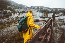 Traveler Woman Climbing Up Stairs In Rocky Mountains Solo Traveling Adventure Lifestyle Active Vacations In Norway