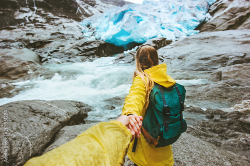 Couple Travelers Follow Holding Hands In Mountains Glacier Love And