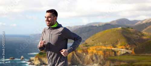 Fotografie, Tablou  fitness, sport, people and healthy lifestyle concept - happy young man running o
