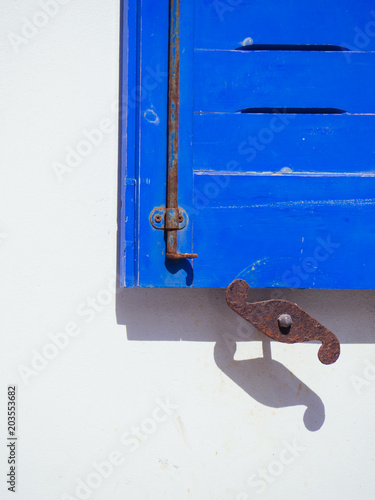 Photo Detail of a wooden blue shutter in Amorgos