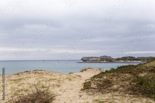 Foto op Plexiglas Kust entrance to a port on the coast on a cloudy day