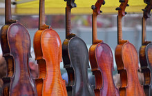 Close Up Sale Of Old Vintage Antique Violins