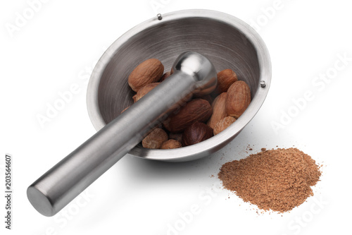 Foto op Canvas Kruiderij Mortar and pestle with nutmeg