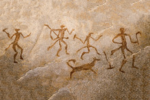 Image Of Ancient Hunters With A Dog On The Wall Of The Cave. Ancient Art, History, Archeology