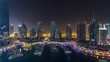 Dubai Marina all night timelapse, Glittering lights and tallest skyscrapers during a clear evening