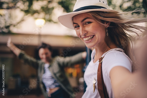 plakat Woman talking selfie outdoors with a friends