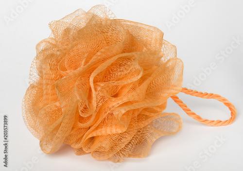 Fotografia Orange washcloth for bathing on white background