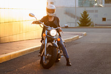 Girl In White Helmet Sits On Sportbike