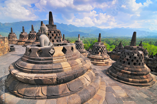 Foto op Aluminium Bedehuis Stupas and Statue of Buddha at Borobudur Temple, Yogjakarta Indonesia.