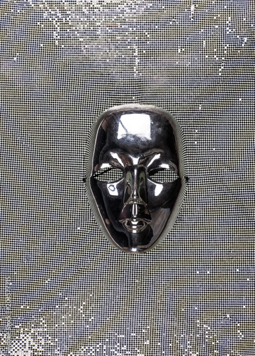 masquerade mask on a gray background