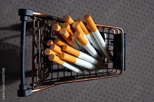 Cuadros en Lienzo A bunch of cigarettes lying in a metal mini cart