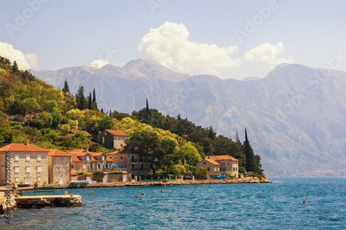 Tuinposter Blauwe jeans Sunny Mediterranean landscape. Montenegro, view of Bay of Kotor and ancient town of Perast
