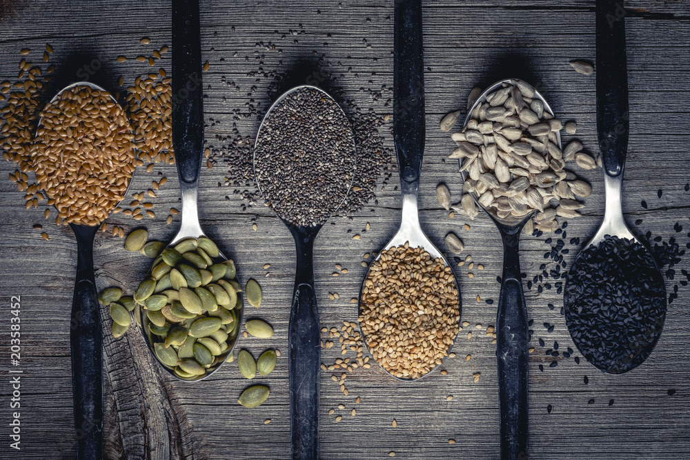 Fototapety, obrazy: Spoons with assortment of seeds