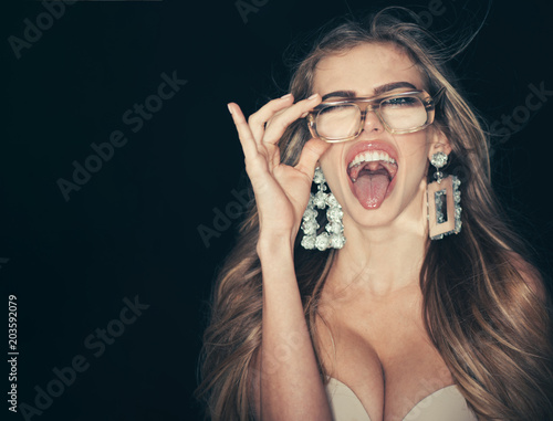 Photo  Woman attractive with big breasts wears ugly eyeglasses for vision