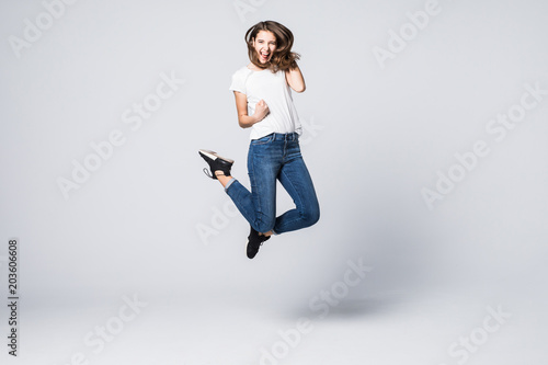 Joy fun enjoy funny crazy mad funky chill positive lifestyle person concept. Full-size view of excited cheerful delight rejoicing pretty woman jumping up isolated on gray background