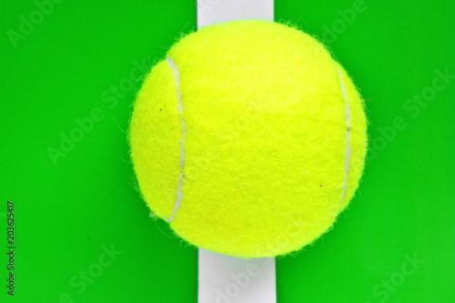 Yellow Tennis Ball On White Border Line Bright Green Background