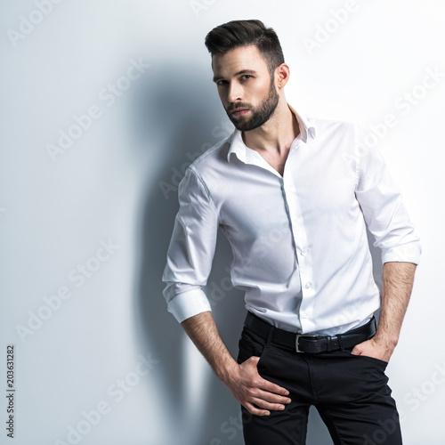 Fotografie, Obraz  Handsome man in white shirt holds the black suit