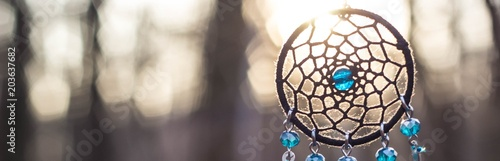Photo Banner of Dreamcatcher made of feathers, leather, beads, and ropes
