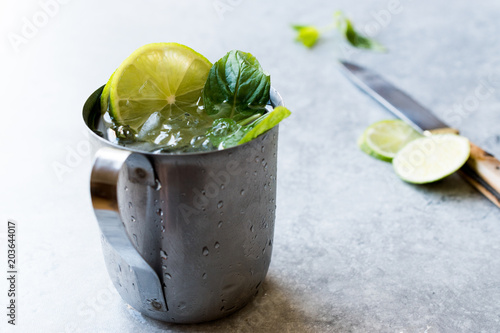 Valokuva  Moscow Mule Cocktail with Lime, Mint Leaves and Crushed Ice in Metal Cup