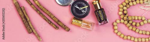 rosary,siwak, perfume and book, muslim compass