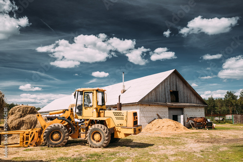 Valokuva  Multipurpose Wheel Loader Carry Out Works In Transportation Of Hay