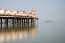 Minimalist Fine Art Landscape Image Of Colorful Pier In Juxtaposition With Old Derelict Pier In Background