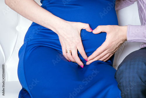 Romantic Pregnancy Pregnant Gir Stomach Couple Pregnancy Closeup Beautiful Young Couple Expecting Baby Pregnancy Concept Couple Making A Heart Shape With Their Hands On The Pregnant Belly Buy This Stock