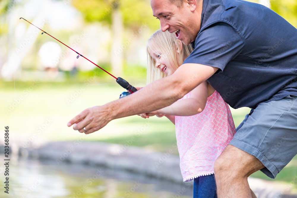Photo  Young Caucasian Father and Daughter Having Fun Fishing At The Lake