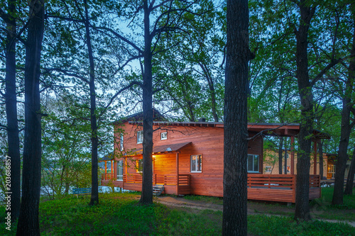 wooden cottage in forest near lake, cabin on lake Wallpaper Mural