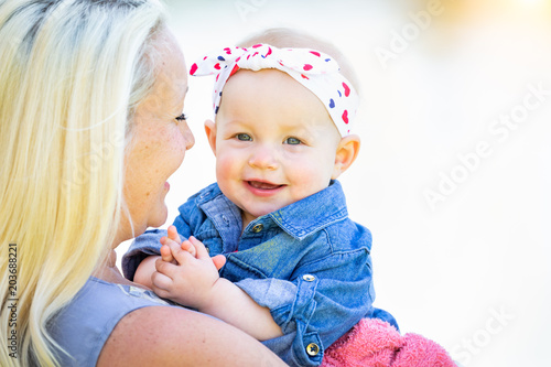 Photo  Young Caucasian Mother and Daughter At The Park